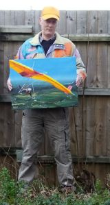 Artist and painting of Miles Wings Gryphon mark 1 hang glider of 1976