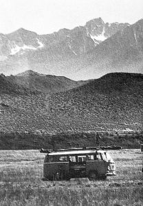 VW bus with hang gliders in the Owens Valley, California, in June 1981