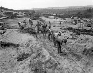 New Zealand army engineers constructing a narrow-gauge railway on St. Catherine's Hill, Christchurch, Hampshire, in 1918. Photo by Thomas Frederick Scales.