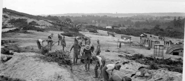 Cropped and leveled photo of New Zealand army engineers constructing a narrow-gauge railway on St. Catherine's Hill, Christchurch, Hampshire, in 1918 by Thomas Frederick Scales