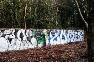 Graffiti on derelict structure set into the west side of Ramsdown Hill, Hurn, Dorset, in 2021