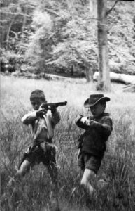 Two brothers with toy rifles in the New Forest