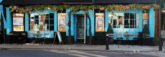 Reflections in Soho cafe windows