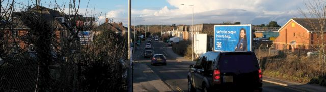 St. Catherine's Hill on the horizon looking north on the pedestrian bridge adjacent to the road bridge over the railway where Fairmile Road adjoins Bargates, in January 2021